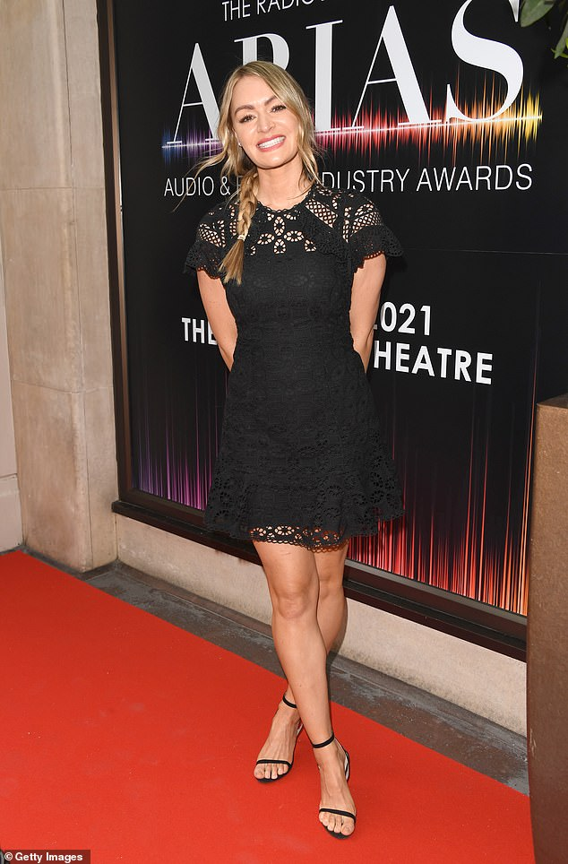 LBD: Sky Sports presenter Laura Woods looked cheery in a little black dress with floral detailing cut-outs, black strap heels and her blonde locks in a jaunty side-plait