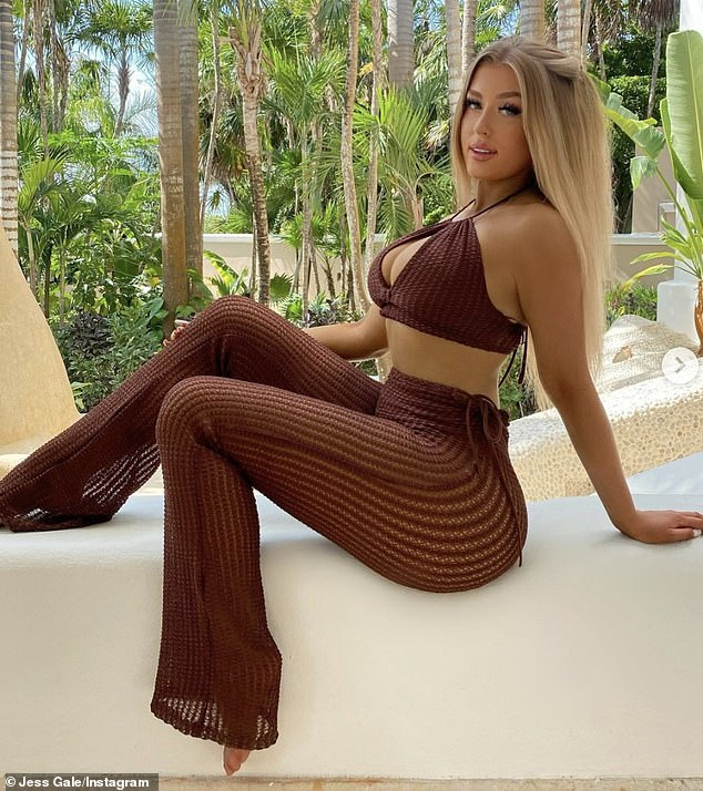 Pose: In another snap Jess wore a knit brown crop top and matching flared trousers as she posed up a storm at their resort