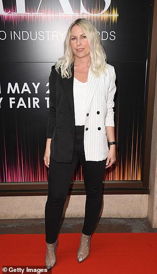 Classic: CharlieHedges looked sensational in a pant suit, made up of black, white and pinstripe panelling
