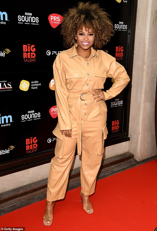 Trendy:Fleur East cut a stylish figure in a cream leather jumpsuit as she attended the the Audio and Radio Industry Awards on Wednesday