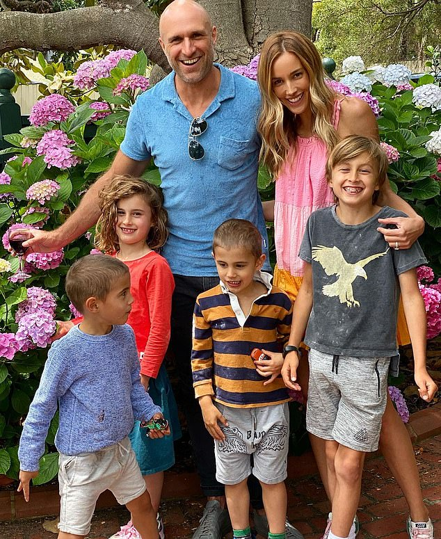 New neighbours? It comes as several footy players are said to be interested in buying a house in same suburb where Rebecca and husband Chris Judd live with their four children (pictured)