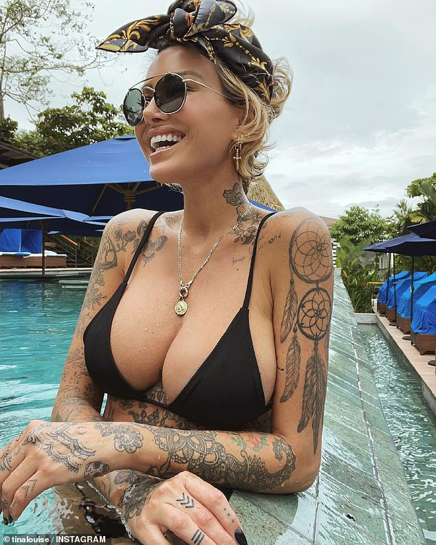 Eye popping! Model and businesswoman Tina Louise put on a busty display in a tiny black bikini on Wednesday after celebrating her 40th birthday in Costa Rica