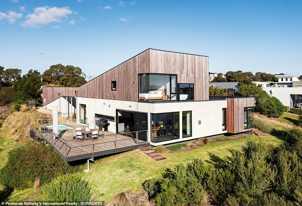 The four-bedroom property in Fingal sits within a private 'gated community' and overlooks the Moonah Links golf course