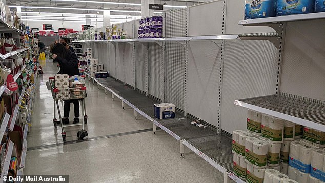 Panic buyers began to strip Melbourne 's supermarket shelves of toilet paper - with shoppers posting pictures of empty shelves just minutes after lockdown was announced. Pictured above is a Coles in Footscray