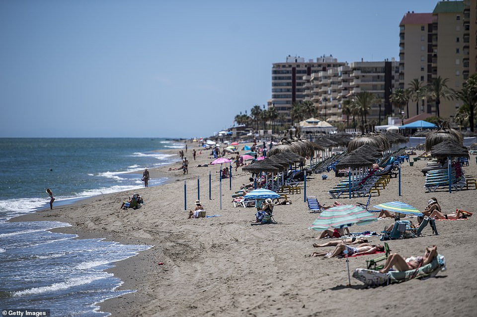 Fuengirola beach near Malaga is pictured on Monday as UK holidaymakers set their sights on a trip to Spain