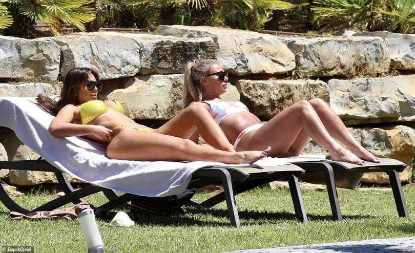Balmy weather: Portugal's balmy weather made a sunny change from the UK's drizzle and the TV stars were keen to make the most of the sunshine while they could