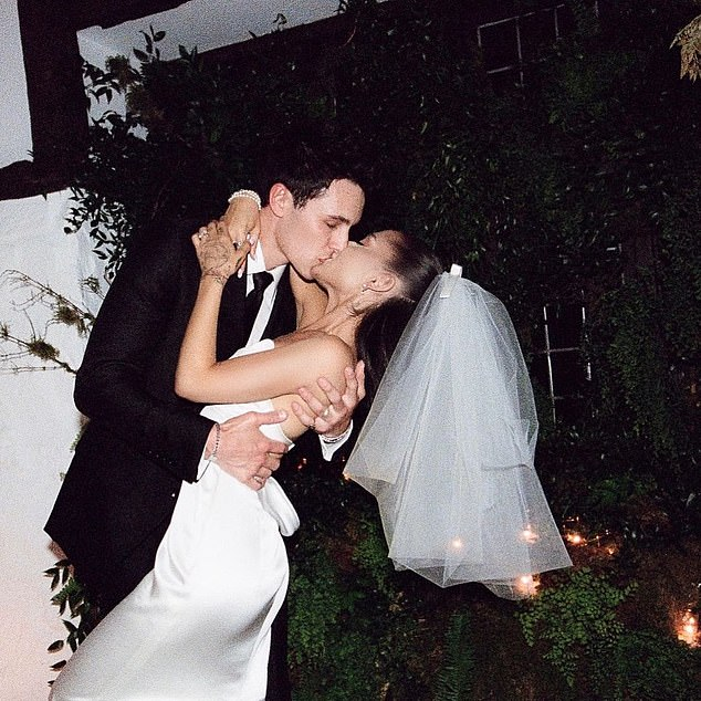 His suit:'Dalton, wearing a Tom Ford suit, waited beneath flowers suspended from the ceiling. Then the couple said their vows, committing to happily ever after, in love forever,' said Vogue
