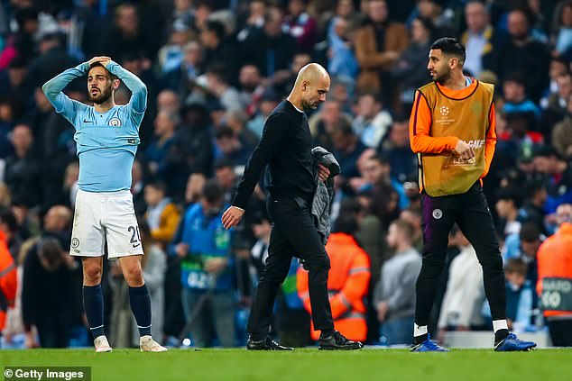 Guardiola looks disconsolate after his Manchester City side are knocked out by Tottenham