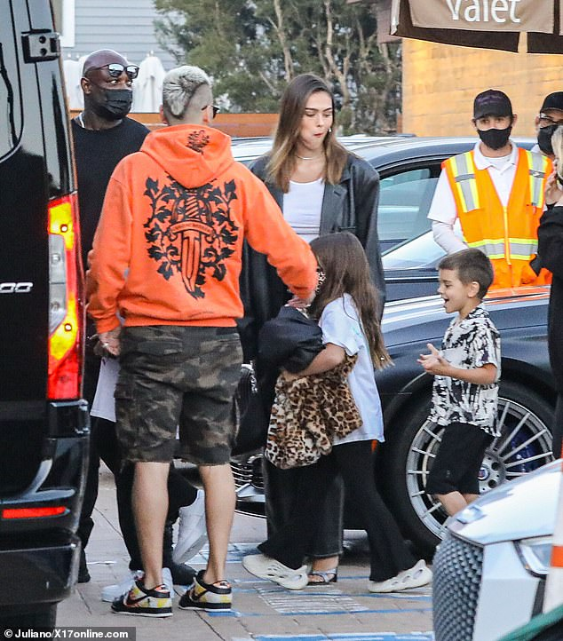 Busy group:Scott, Amelia and his three children were seen getting into a van with pals and security in tow