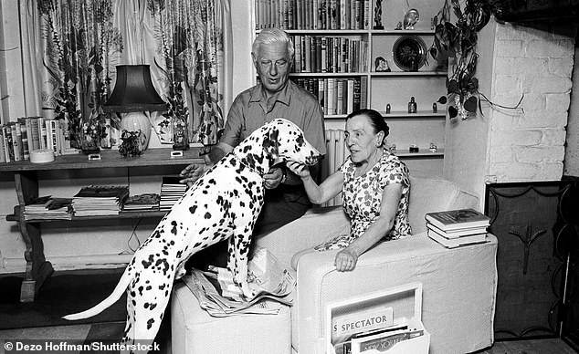 Iconic: Playwright Dodie, who more than 20 years later, having never forgotten Joyce's remark, wrote her first children's book, One Hundred and One Dalmatians (pictured with her dog Pongo and husband Alec in the Fifties)