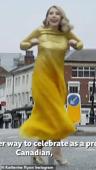 Having fun: Katherine spun around and danced in the clip