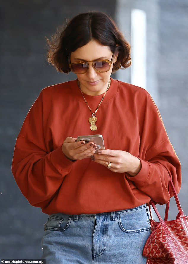 Style:The Go-To Skincare founder looked stylish but casual in a pair of baggy boyfriend jeans and a dark red sweater