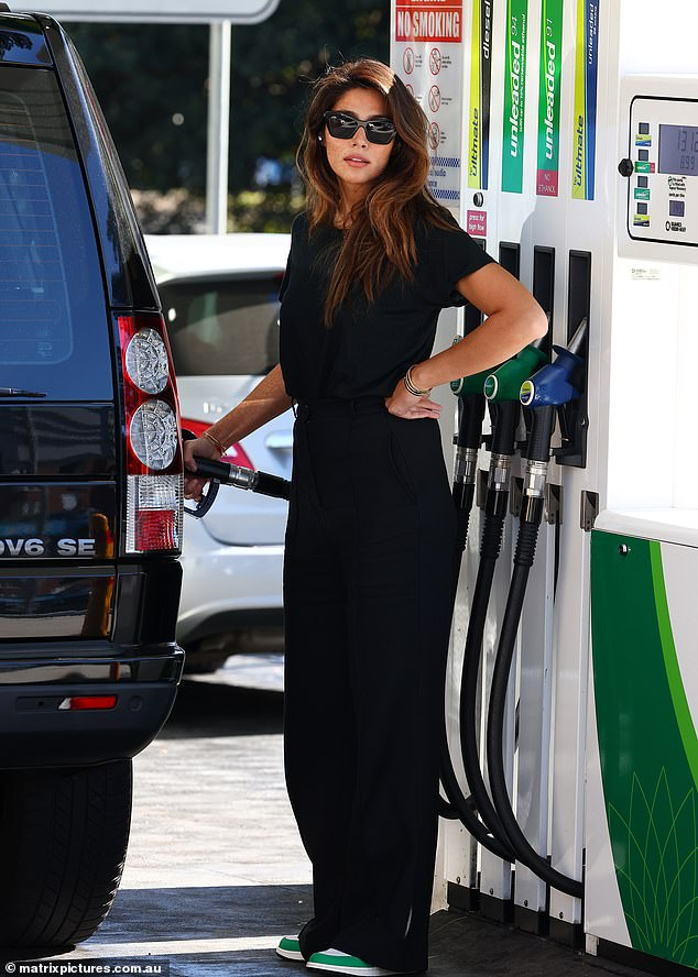 Style: The former Home and Away star looked stylish in an all-black outfit comprising a T-shirt and wide legged pants.She teamed her ensemble with green sneakers and chic sunglasses