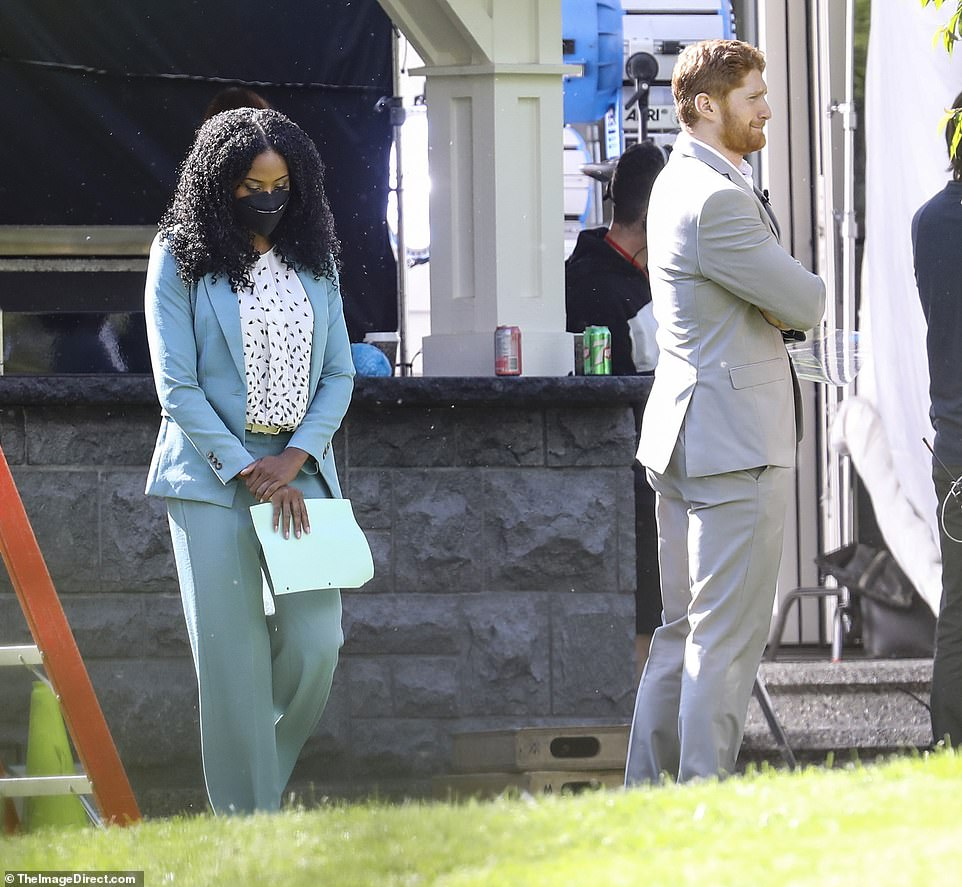Prepping lines: Dean, who plays the Duke of Sussex, had a few minutes spare in between filming scenes