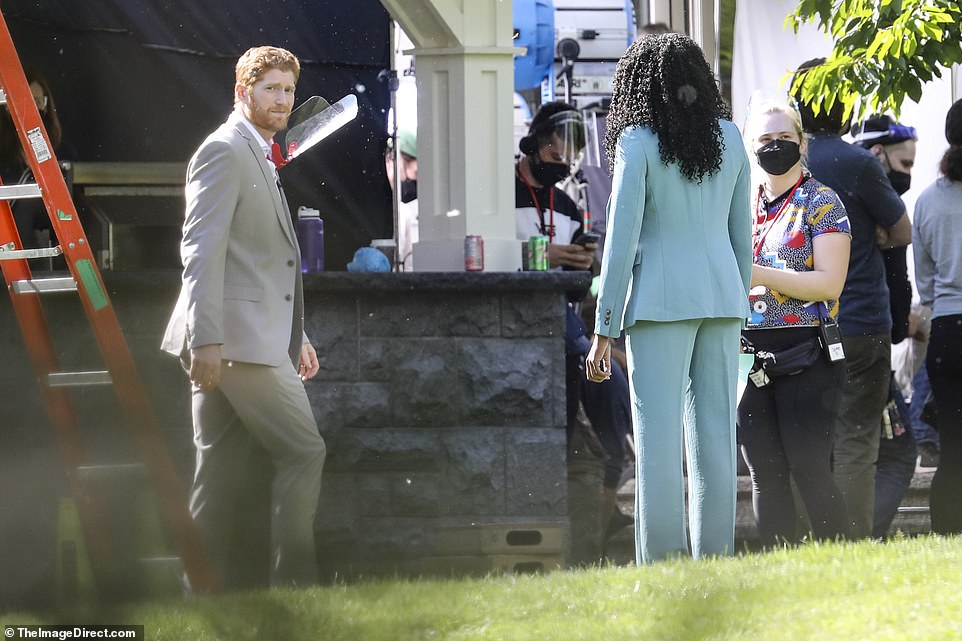 Brief exchange: It appeared Dean spent time talking to the woman in the blue suit, whose name is not known