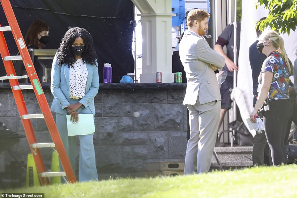 Taking time out: The actor, who channeled the prince in his grey tailored look, appeared laid back on the set of the movie