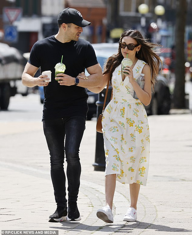 Lean: The former TOWIE star cut a trim figure and accentuated his shapely legs in indigo skinny jeans
