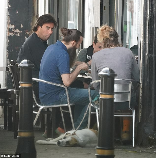 All together:The TV personality was then seen sitting down with his pals as they tucked into breakfast