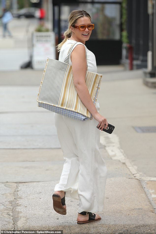 Beaming beauty! Australian model Georgina Burke flaunted her midriff in an all-white outfit while out for a stroll in New York City