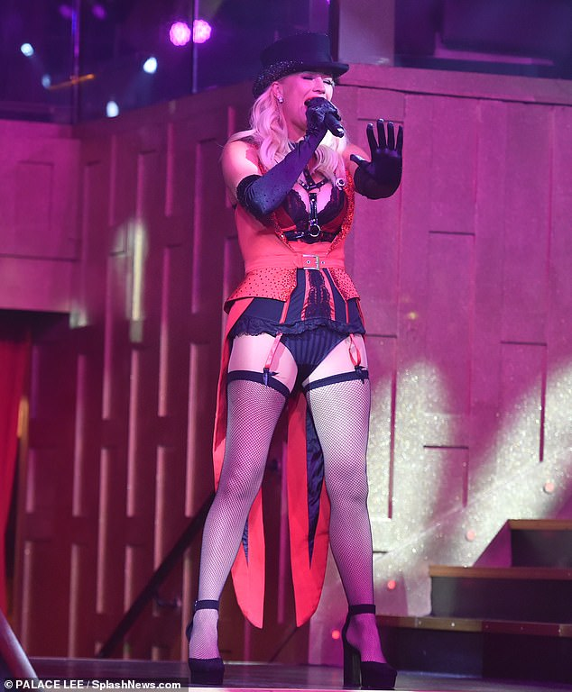Sizzling: The leading lady looked sensational when she took to the stage in a black and red cabaret ensemble