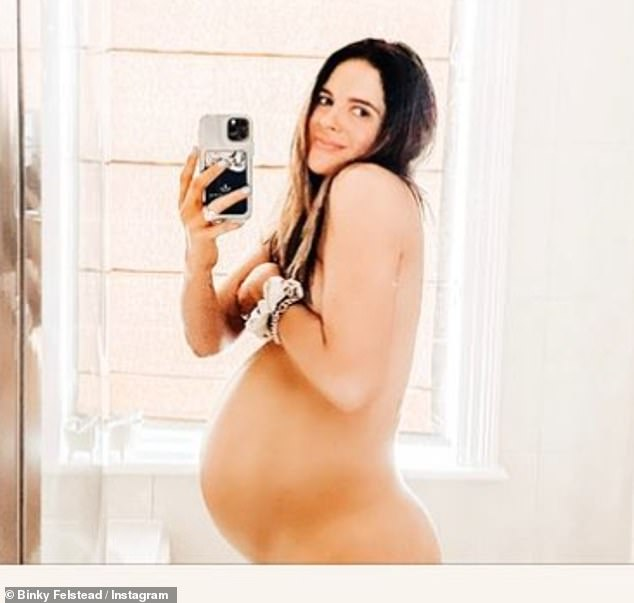 '39 weeks': The mother-of-one shared a snap of her 39-week-old bump in a naked mirror selfie on Instagram on Saturday as she counted down the days until they become a family of four