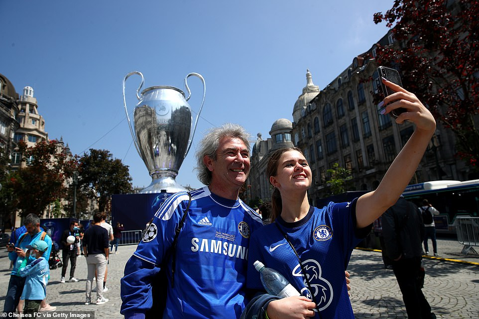 Chelsea fans take a selfie with a Giant UEFA Champions League Trophy ahead of the UEFA Champions League Final between Manchester City and Chelsea
