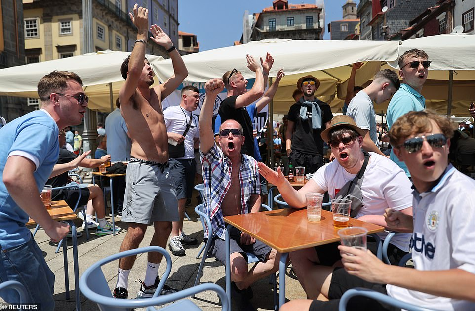 A group of lads cheer as they drink and party in Porto before kick off between Chelsea and Manchester City in the final tonight