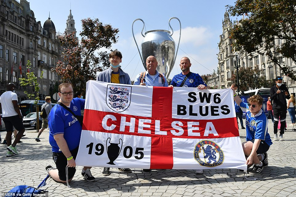Fans of Chelsea pose for a photograph ahead of the UEFA Champions League Final between Manchester City and Chelsea tonight
