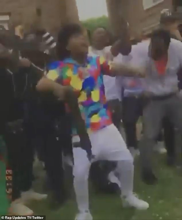 Weapons on set: In the clip, the rapper was seen standing amongst a group of people who were wielding assault rifles