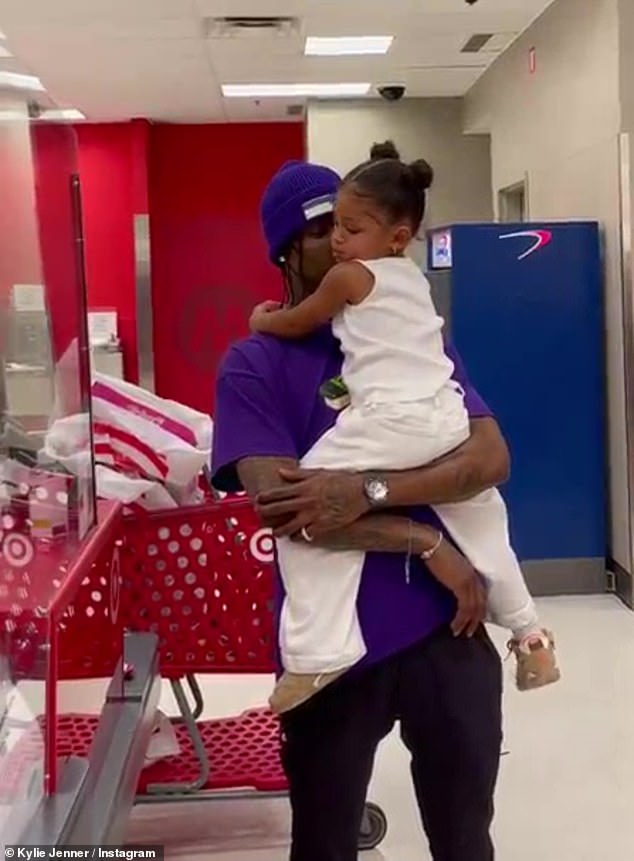 Doting parents: After touching down, Kylie and Travis, 29, made a Target run with their toddler, who was dressed in all white for their travels