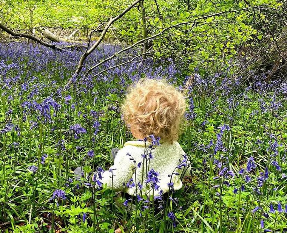 Ms Symonds shared a picture of their son yesterday in a field of bluebells - which some speculated was a nod to the tradition of 'something blue'