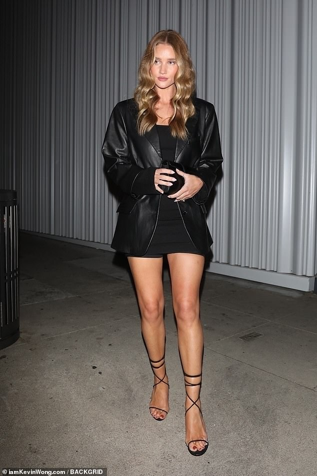 Glamour:Adding height to her frame with a pair of black heels, the Transformers star also carried a matching clutch bag
