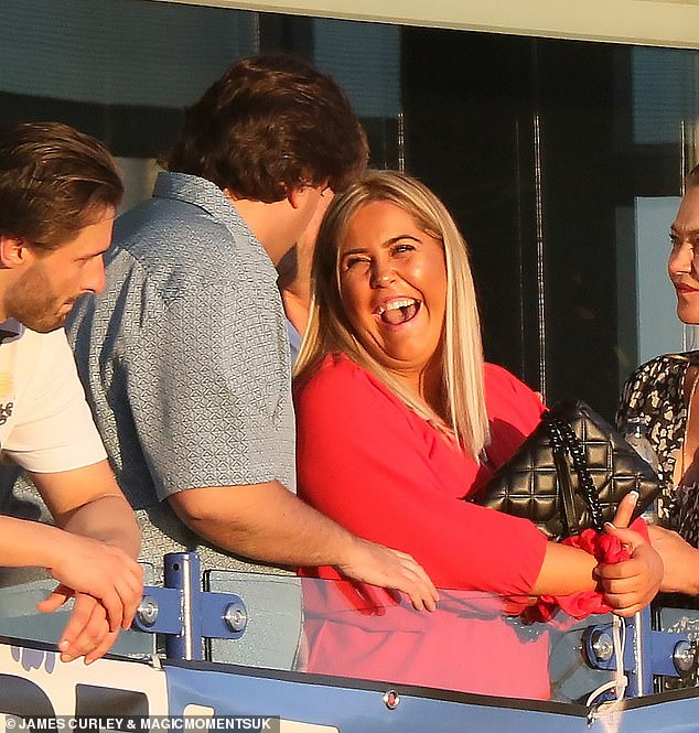 All smiles: The pair laughed and joked as they watched the football in the sunshine