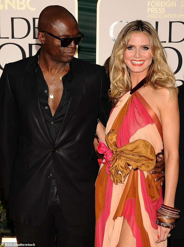 Dad: Leni's biological father is Heidi's ex Flavio Briatore, but Seal, whom Heidi married in 2005 and divorced in 2014, is her adopted father. Heidi and Seal are pictured in 2011