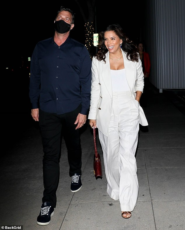 Keeping it consistent: The Desperate Housewives actress also wore a matching pair of pleated pants and a slightly brighter t-shirt during her night on the town