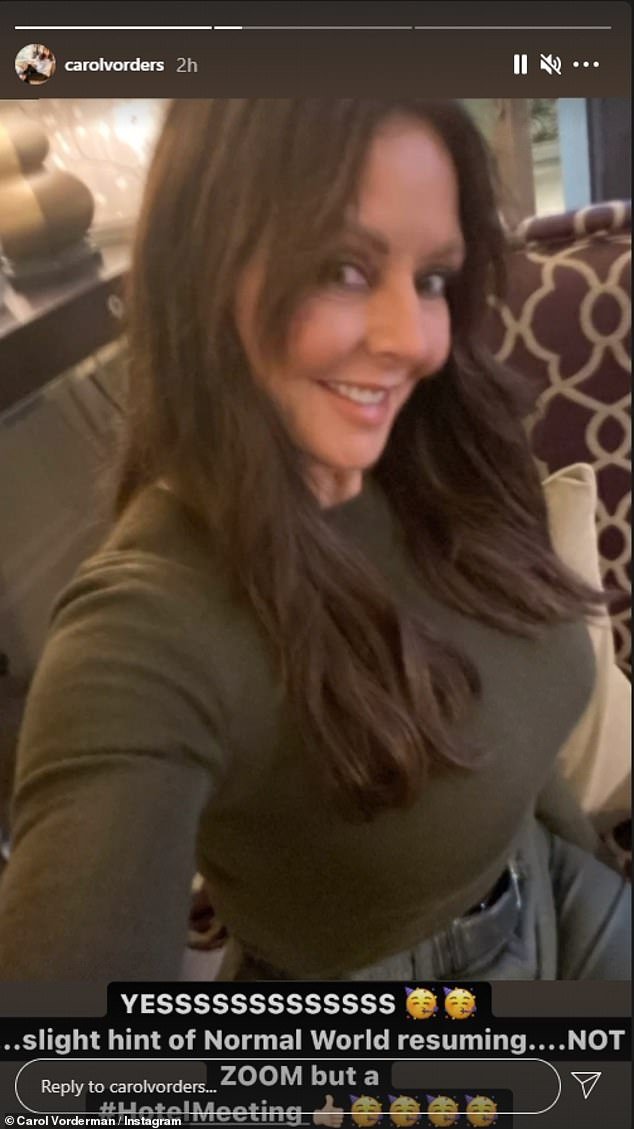 Hot stuff: In one photo the presenter showed off her toned physique in a khaki jumper and grey jeans as she beamed for the camera after a hotel meeting