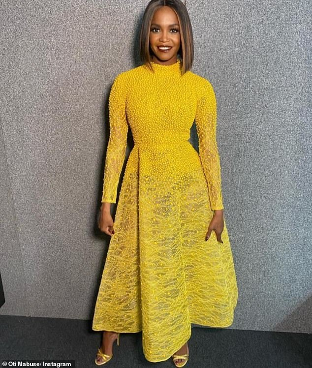 Stunning:Oti also took to Instagram on Sunday to showcase her jaw-dropping outfit, revealing that she had opted for a striking yellow gown