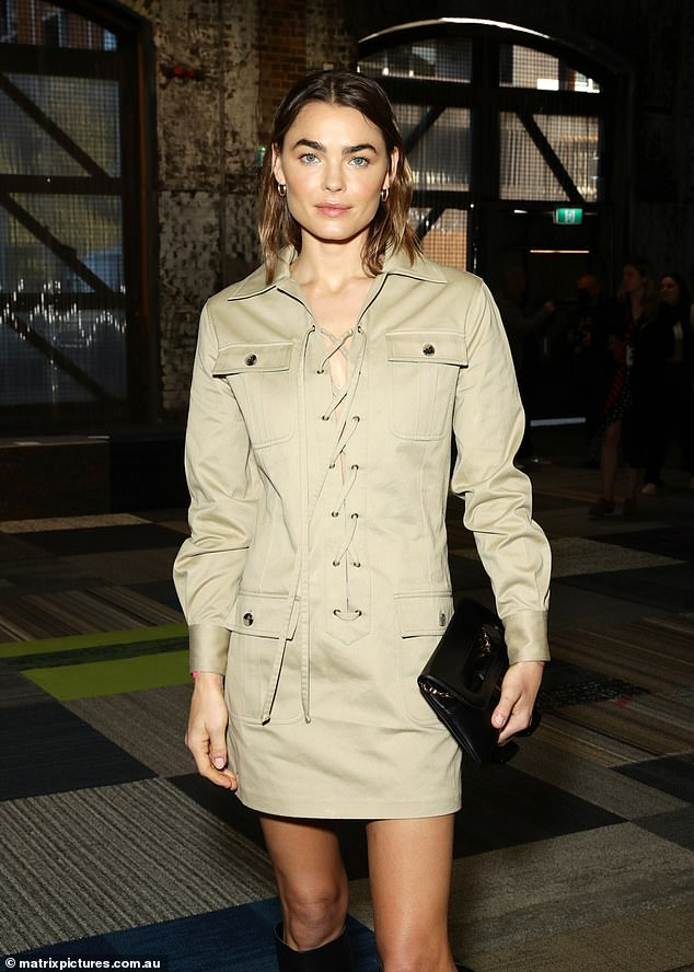 Fashionista: She arrived at the industrial chic venue in a camel-coloured mini dress with lace-up front detailing, andaccessorised her look with a black clutch