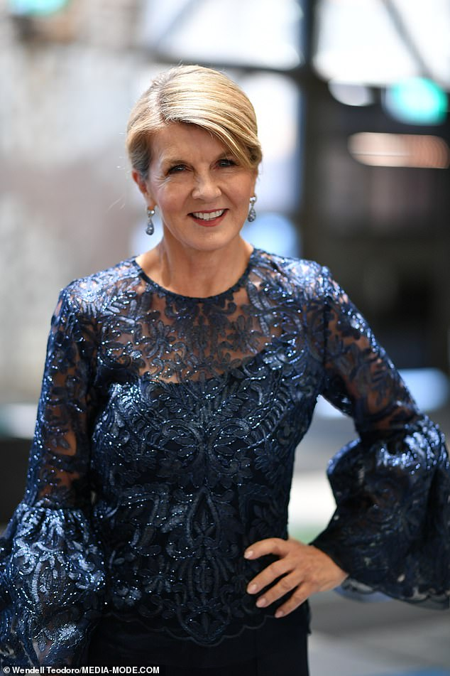 Glowing: The former Australian Foreign Affairs minister, 64, accessorised with a pair of shimmering earrings. Shestyled her blonde tresses in a low bun and opted for a radiant make-up look