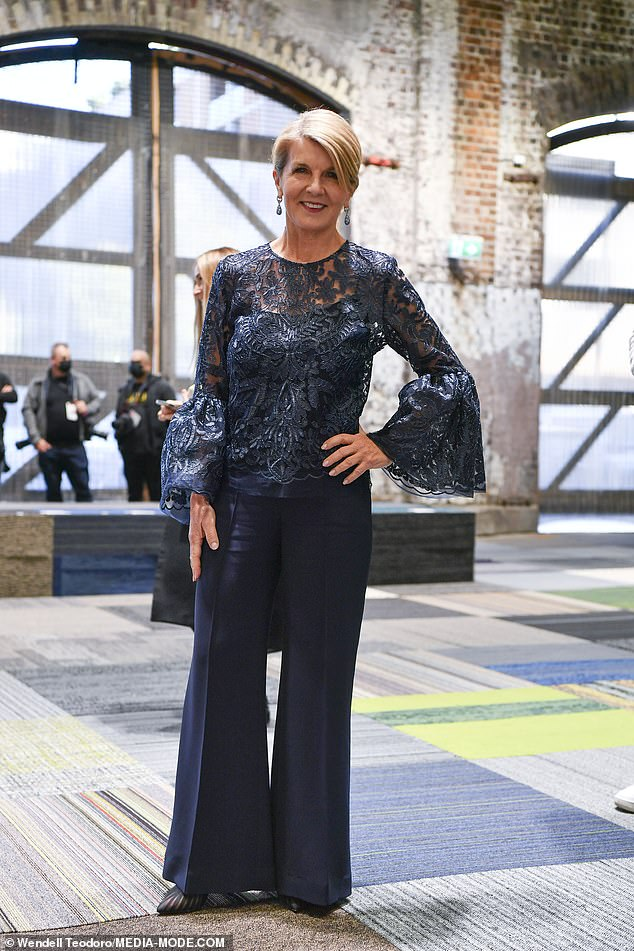 The Minister for fashion is in! Julie Bishop looked chic in a navy blue ensemble with a lace top as she stepped out to attend the Jordan Dalah show atCarriageworks in Sydney's Eveleigh for Australian Fashion Week on Monday