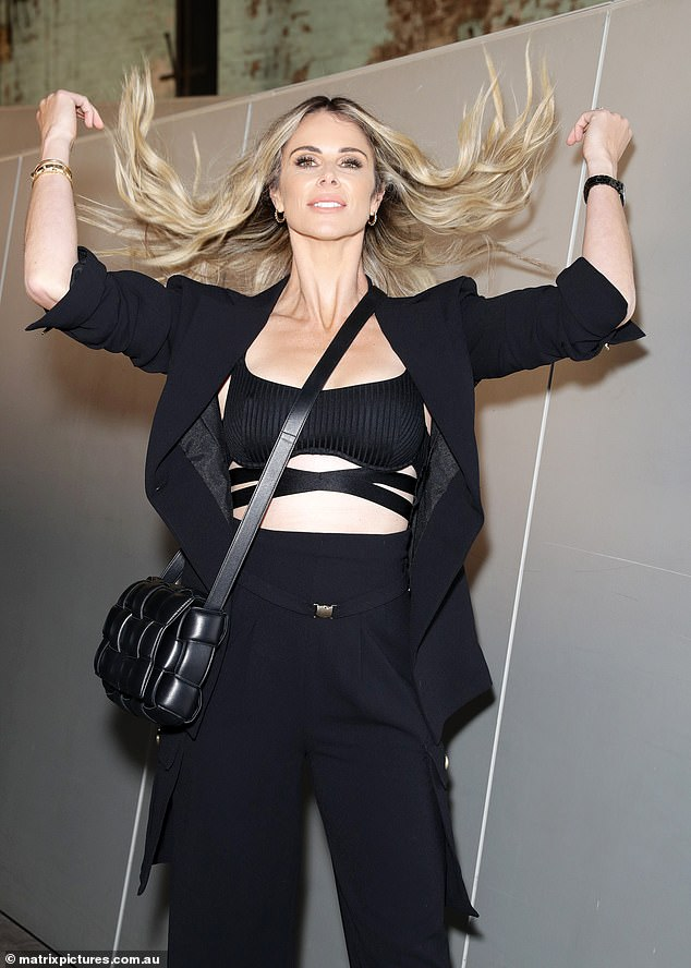 Oh la la: The 35-year-old made a statement as she flaunted her abs and tossed her blonde tresses around at fashion week ensuring all eyes were on her