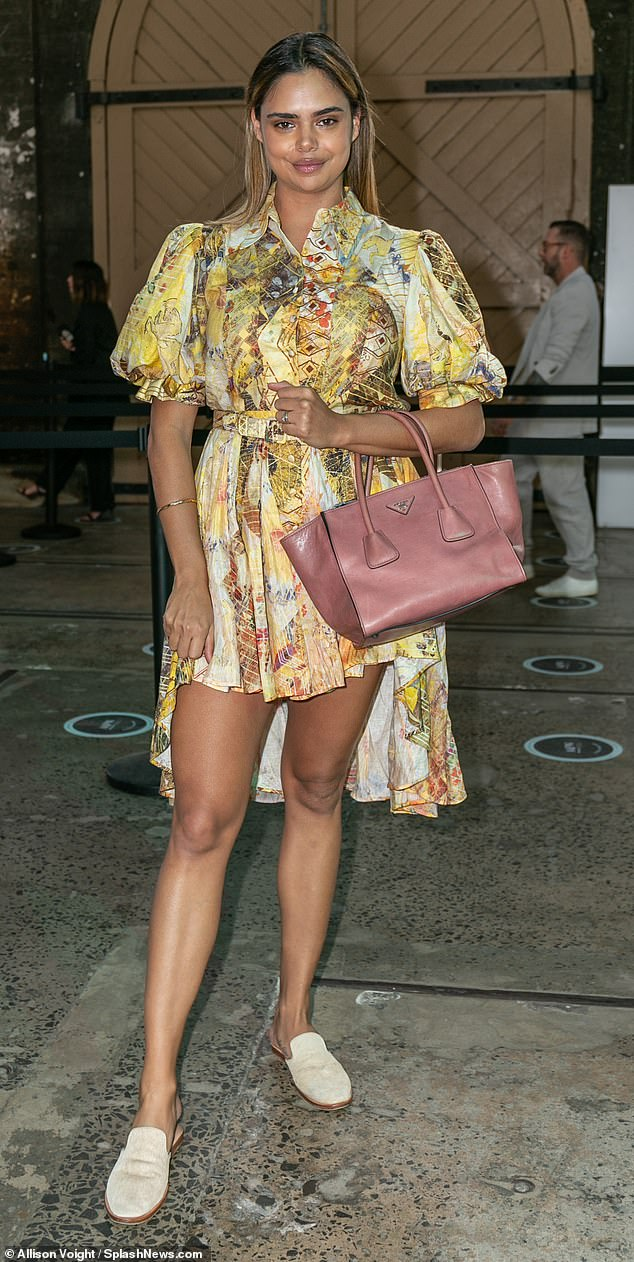 Trend-setting: Model Samantha Harris took a fashion risk by wearing a patterned high-low dress in yellow and orange