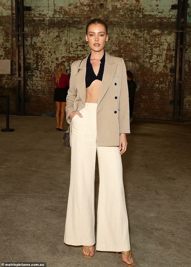 Flare for fashion!The blazer and trouser combo was in full force on Monday, with model Georgia Gibbs also sporting a khaki blazer and white flare trousers to the fashion event