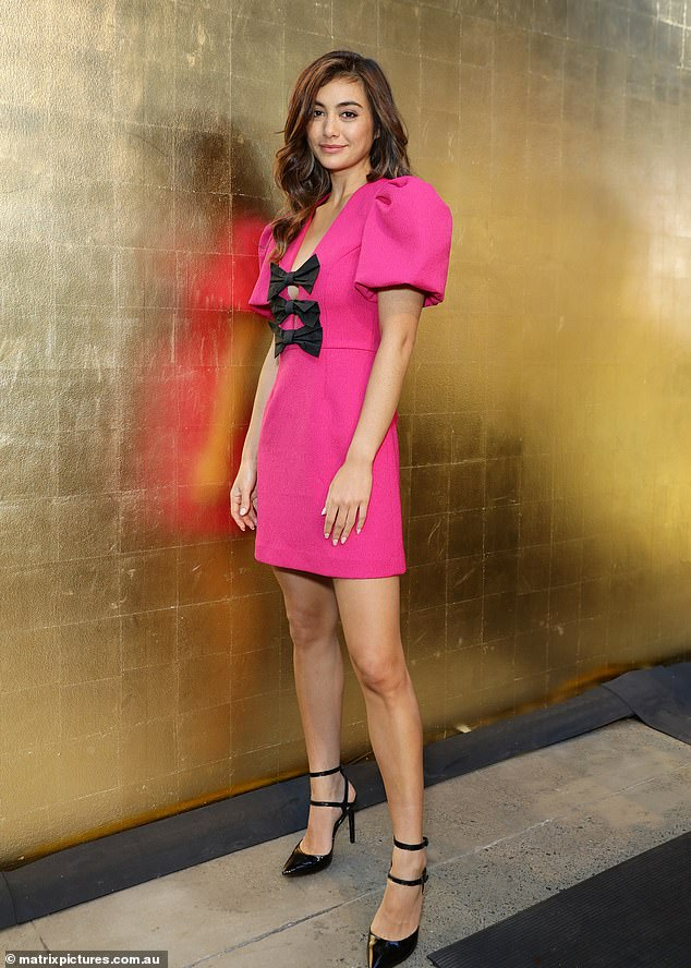 Pop of pink!Former Miss Universe Australia Francesca Hung dared to stand out from the crowd in a puff-sleeved fuchsia frock with bow detailing