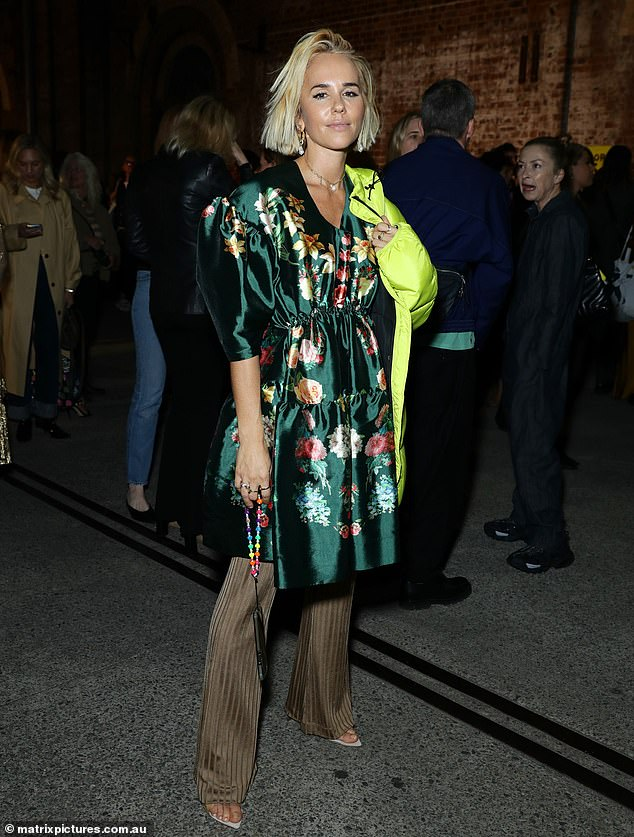 Not bothered? Pip Edwards appeared unfazed as she showed off her style credentials at the Romance Was Born Australian Fashion Week show in Sydney on Monday (pictured) - amid reports her former flame Michael Clarke has reunited with ex-wife Kyly Clarke