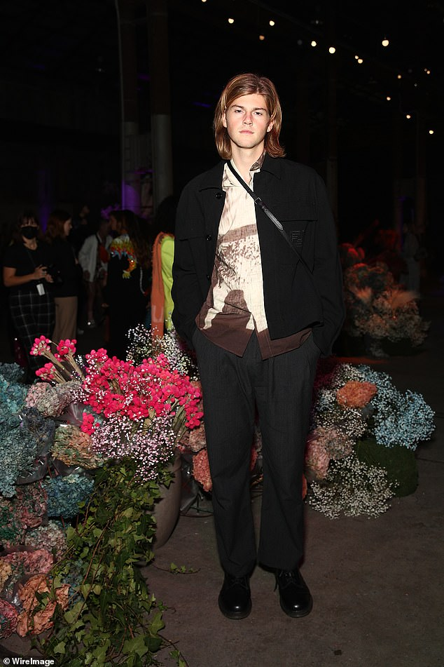 Fashion:Meanwhile, singer Ruel, 18, was casually chic in a beige and brown artistic shirt worn with a black blazer and slacks
