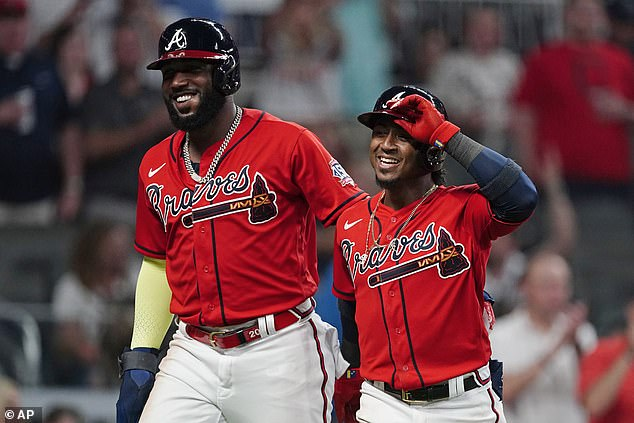 Ozuna (left), a two-time All-Star, signed a four-year, $65 million deal with the Braves prior to the season. He has earned nearly $50 million in his career, according to spotrac.com