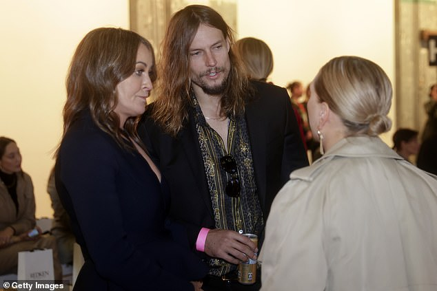 Edge:Model David, 41, looked edgy in a rock-inspired ensemble composed of black skinny jeans and a black satin blazer