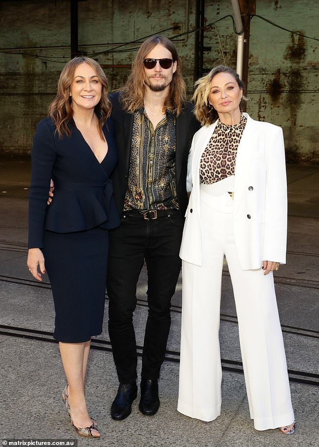 Stars:Michelle Bridges teamed up with her Celebrity Apprentice Australia co-stars at the Afterpay Australian Fashion Week on Monday. Pictured with David Genat and Camilla Franks