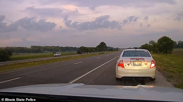 The Illinois State Police released dash cam footage of the May 24 incident which took place just after 8pm on John Deere Road in Moline, a town that lies along the Illinois-Iowa border about 180 miles west of Chicago